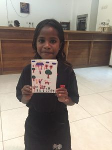 Joanina with a 'Thank you' card she designed for her sponsor