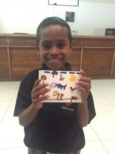 Natalino with a thank you card he designed for his sponsor